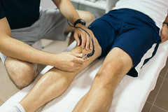 Laser therapy on a knee used to treat pain