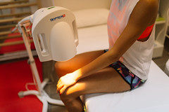 Physiotherapy laser knee therapy session on arm