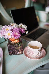 Flowers, coffee and notebook for morning