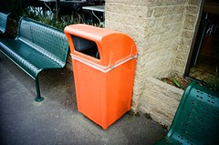 Orange rubbish bin