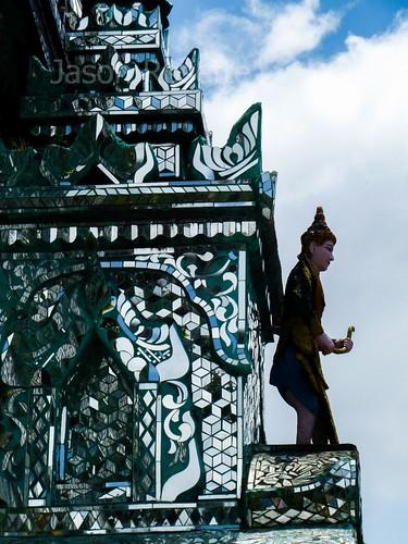 Profile of Dark Angelic Figure Atop Mirrored Temple, Yangon