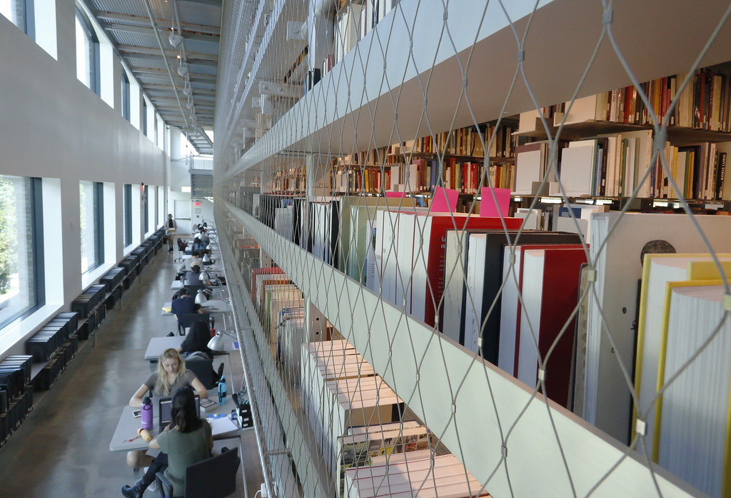 A view of the book stacks and study carrels along the north side of the library.