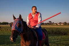 Man with spear on horseback