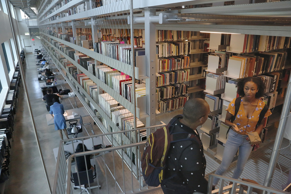 A view of the book stacks and study carrels along the north wall of the Mui Ho Fine Arts Library.