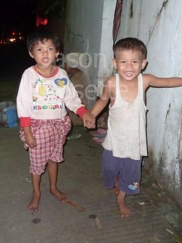 Boy and Girl Play in an alley at Night, Rangoon Burma