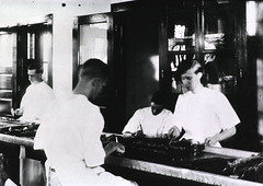 Lab workers preparing captured rats for examination, New Orleans, La