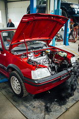 Peugeot 205 cabrio with open hood in auto repair shop