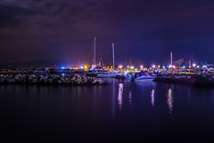 Small marina in Paralia, Greece at night