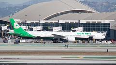 EVA Air Boeing 777 -300 (ER) B-16712 at International gate, luggage doors open.  DSC_0096