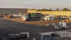 Truck waiting to be loaded at a metal scrap yard