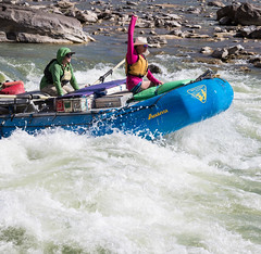 Explorers excitedly raft down the Green River of Utah's Desolation Canyon Area in a raft