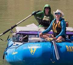 Excited explorers survey Utah's Desolation Canyon Area by raft in the Green River