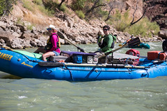 Explorers coast down the Green River of Utah's Desolation Canyon Area in a raft