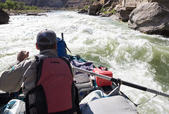 A park ranger surveying Utah's Desolation Canyon Area by raft in the Green River