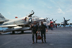 Vietnam War 1965 - Navy Soldiers Walking with Bombers in Background
