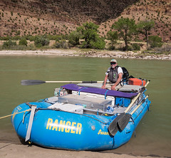 A BLM park ranger aboard his raft in the Green River