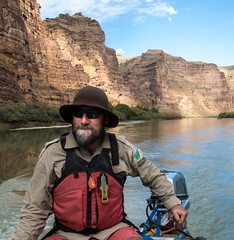 A BLM employee navigates the Green River in Utah's Desolation Canyon Area