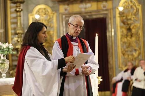 Archbishop Justin Welby is assisted by his chaplain, The Revd Isabelle Hamley, in leading the prayers