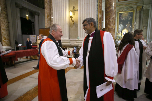 Archbishop Ian Ernest is congratulated after the service