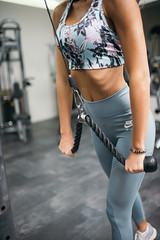Young woman exercising at the gym.