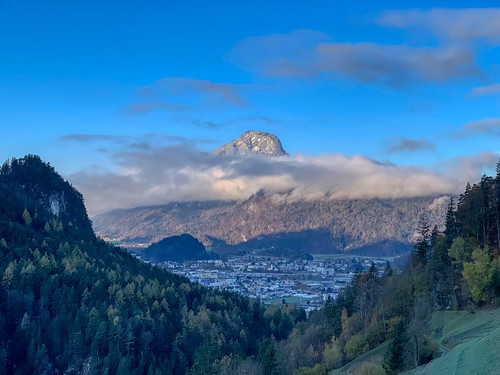 View of Kufstein and clouded Pendling mountain from Zahmer Kaiser mountains in Tyrol, Austria