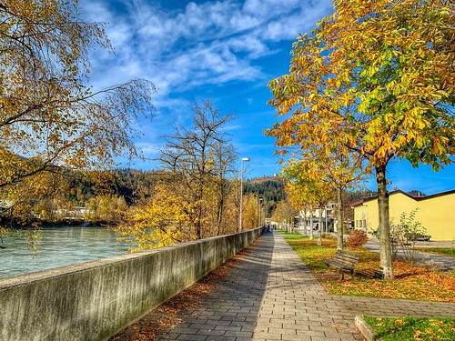 Promenade along the river Inn in autumn in Kufstein, Tyrol, Austria