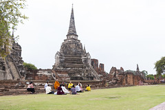 A monk and his devotees in front of a giant chedi of Wat Phra Si Sanphet in Ayutthaya 2