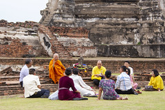 A monk and his devotees in front of a giant chedi of Wat Phra Si Sanphet in Ayutthaya 1