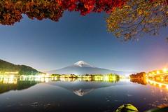 Autumnal Mount Fuji reflected in Lake Kawaguchi at night.