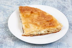 Traditional Balkan cheese pie Burek served on the plate