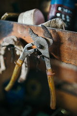 Old pliers on the wall in the workshop