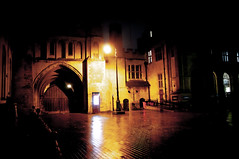 Norman Arch gates at Peterborough Cathedral at night in the rain