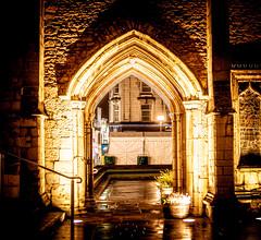 Norman Arch gates at Peterborough Cathedral at night