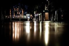 Bridge Street in Peterborough UK reflection of lights in the rain on pavement