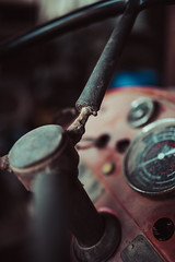 Close-up view of rusted steering wheel on an abandoned tractor