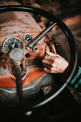 Old man's hand on tractor dashboard