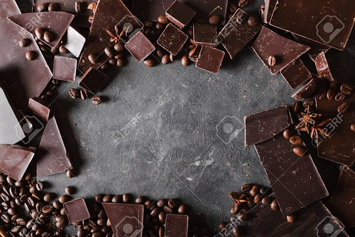 Coffee beans and dark chocolate. Chocolate bar . Background with chocolate. Coffee beans. Cinnamon sticks and star anise