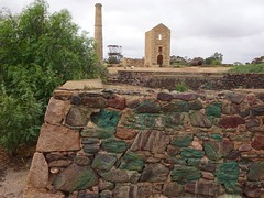 Moonta copper  Mine. Stone monuments by Walter Watson Hughes. The Hughes Boilerhuose and chimney, the Hughes Enginehouse and in the foreground the Hughes three water tanks. All built 1865.Copper rich stones used.
