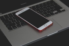 shallow-focus-photo-of-silver-iphone-6-on-gray-laptop-2005192