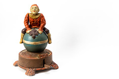 Antique  Style Cast Iron Wind-Up Clown on Ball Coin Bank