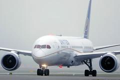 United Airlines Dreamliner 10 plane in Munich Airport, fog