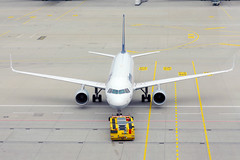 Lufthansa airplane being towed in Munich Airport, view from above