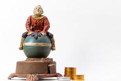 Antique  Style Cast Iron Wind-Up Clown on Ball Coin Bank - Standing on HIs Head