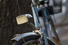Close-up of a headlight on a retro bike