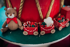 A little honey toy and wagons on the christmas cake
