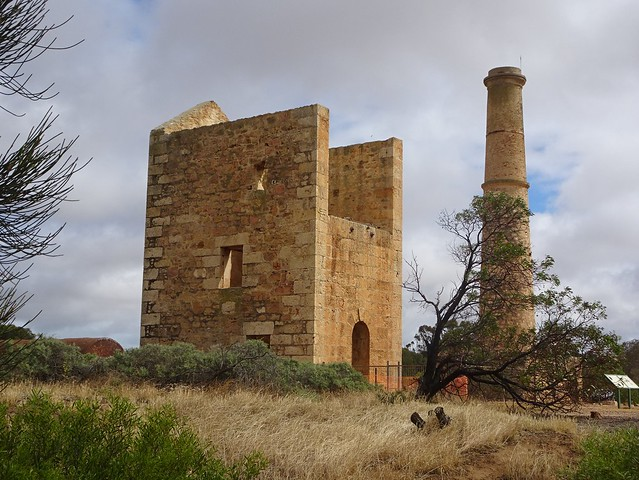 Photo:Moona Mines  copper mining site. Hughes Enginehouse built 1865 and the Hughes Boiler House and chimney built 1865. Nearby the Hughes, Elder and Barr Smith shafts. Three boilers imported from Cornwall. By denisbin