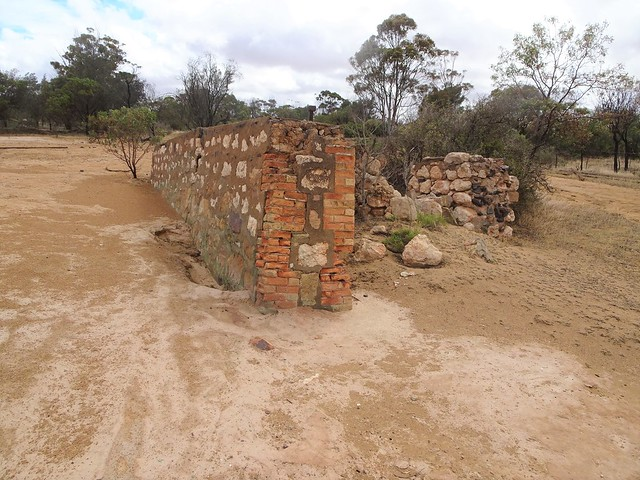 Photo:Moonta Mines historic copper mine site. The ruins of the Hughes Smith and Elder shafts' concentrating plant near the Hughes Enginehouse. Built 1865. Sea water was pumped here and mixed with sulphuric acid. By denisbin