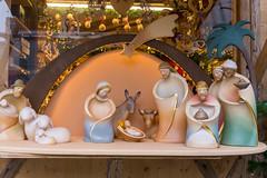 Christmas market sells Porcelain figurines like Baby Jesus for nativity scene