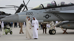 Attendees take a selfie in front of an F/A-18 Super Hornet at the Dubai Airshow.