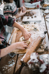 Young girls make dough. Hands close up